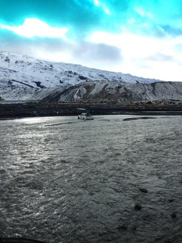Crossing river Krossá, Iceland
